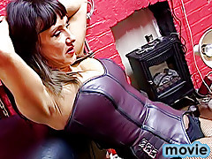 Smoking domme makes her cross-dressed male slave lick her boots clean and spanks his ass red when he misses a stain