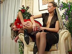 Cute sissy clad in a pretty French maid outfit gets dildo fucked by a girl