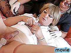Stunning transvestites are ready to have some fun and blonde chick in white clothes and stockings is made to spread legs wide open