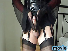 Nylon bitch Yvette slowly rubs her hard cock with sexy gloves on