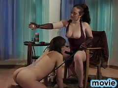 Dolled-up mistress wakes up her puppy for some perverted BDSM play
