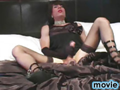 TGirl zoe shoots all over herself in bed