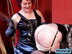 Flogged by the brush on the ass, a sissy undergoes a tough jumbo busting procedure