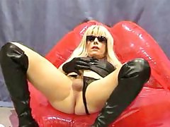 Sexy Candi poses on a set of inflatable lips and plays with her hard TGirl cock.