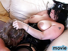A good portion of flogging by two cross-dressed transvestites