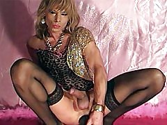 Slutty tranny Kim is wearing a gorgeous basque and fucking her ass with a monster toy