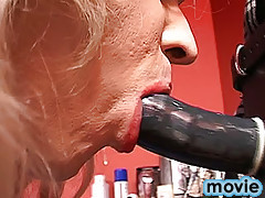 Now it's high time for blond crossdresser to press his lips to brunet's cock