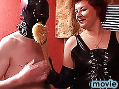 Experienced mature lady in black dress tells crossdresser in yellow dress